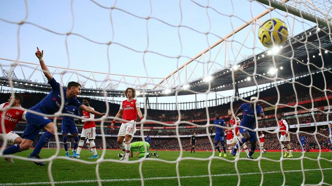 Chelsea's Jorginho (left), celebrates after scoring his side's first goal during the English Premier League soccer match against Arsenal, at the Emirates Stadium in London, on December 29, 2019. (AP)