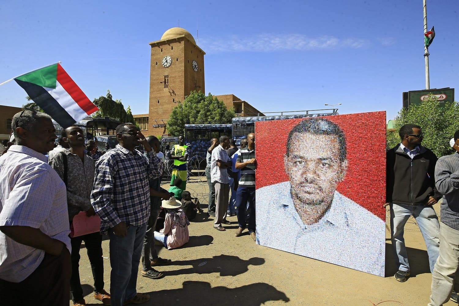 Sudanese protesters rally in front of a court in Omdurman near the capital Khartoum, on December 30, 2019, during the trial of intelligence agents for the death of teacher Ahmed Al-Khair (picture) while in custody of intelligence services. The court sentenced 27 intelligence agents to death by hanging, for torturing and killing the teacher at an intelligence services facility during protests a year ago, judge Sadok Albdelrahman said. (Photo: AFP)