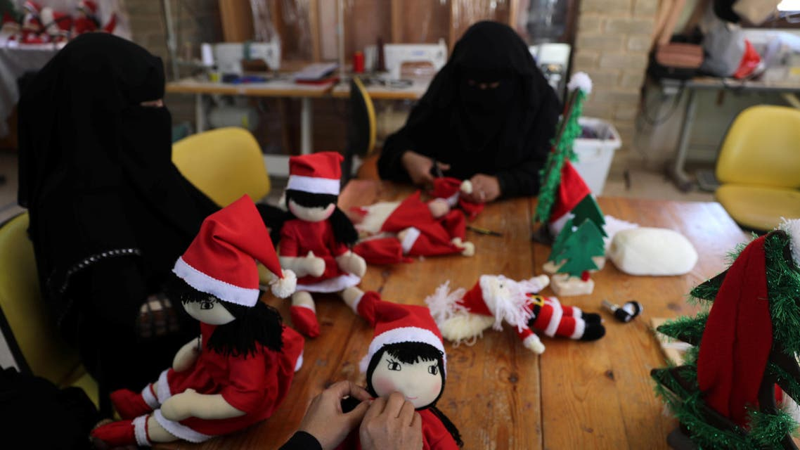 Palestinian women wearing face veil, niqab, make Santa-themed Christmas toys in the northern Gaza Strip December 29, 2019. Picture taken December 29, 2019. REUTERS