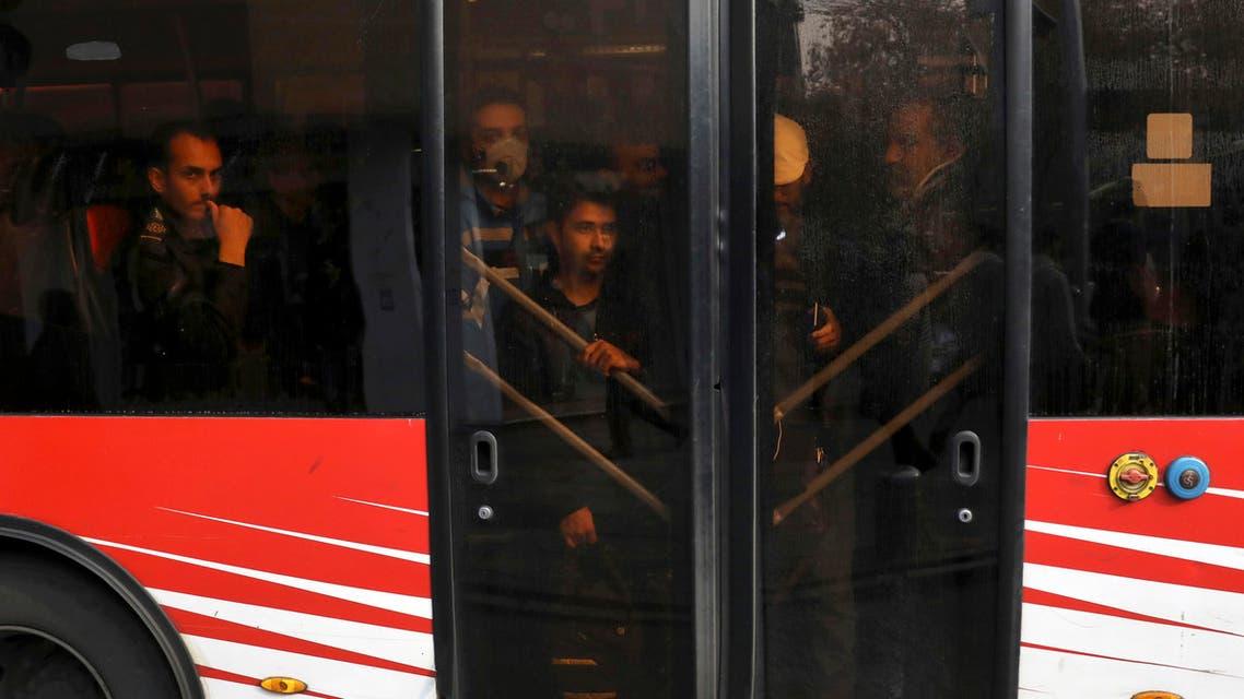 Passengers travel on a public bus in downtown Tehran, Iran, Thursday, Dec. 5, 2019. (AP)