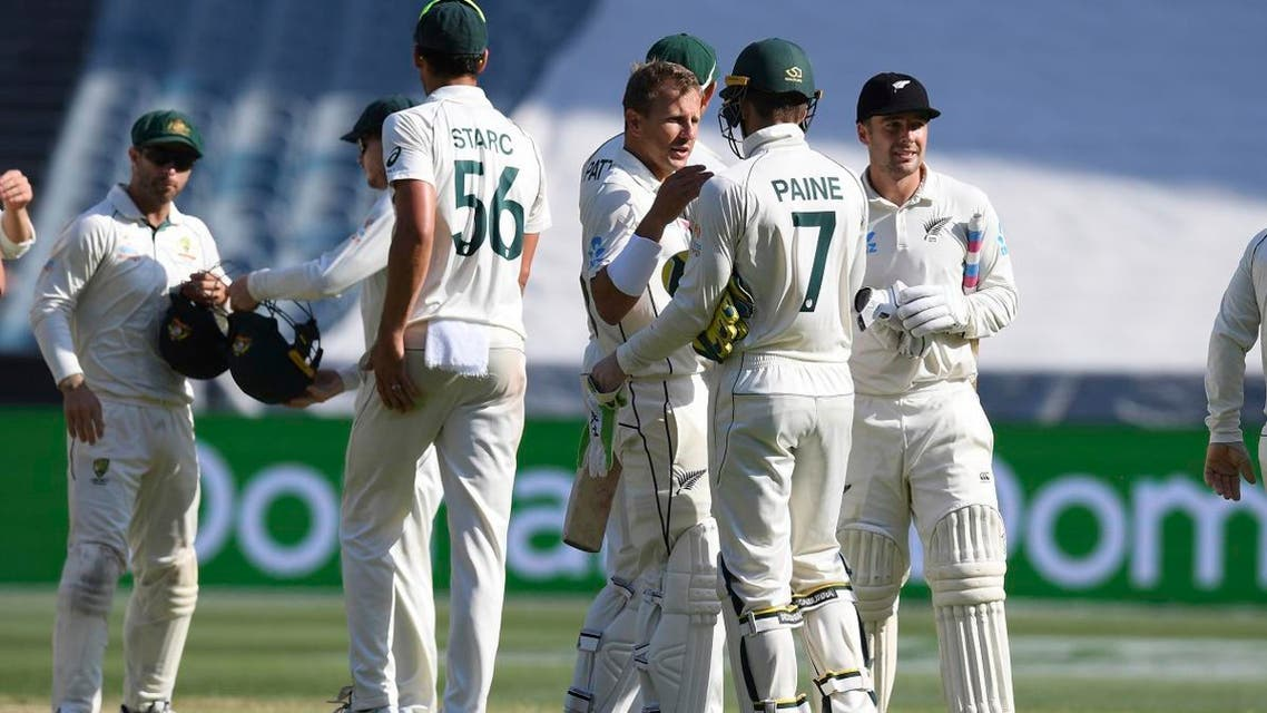New Zealand and Australian players shake hands after the cricket test match in Melbourne, Australia, on December 29, 2019. (AP)