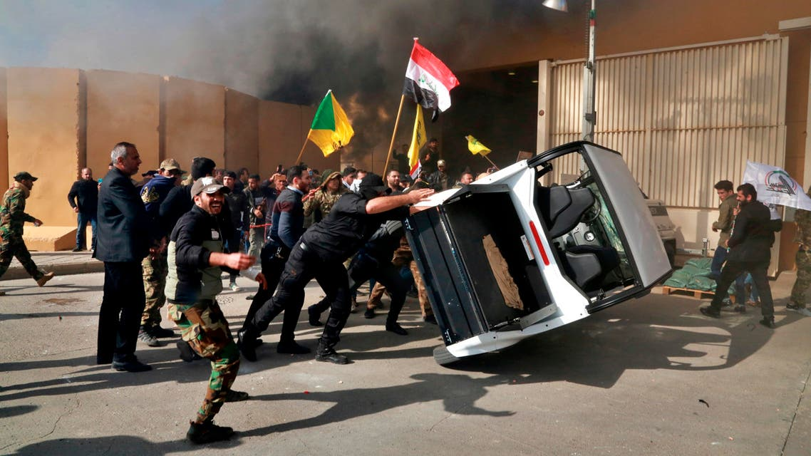Protesters damage property inside the U.S. embassy compound, in Baghdad, Iraq, Tuesday, Dec 31, 2019. (AP)