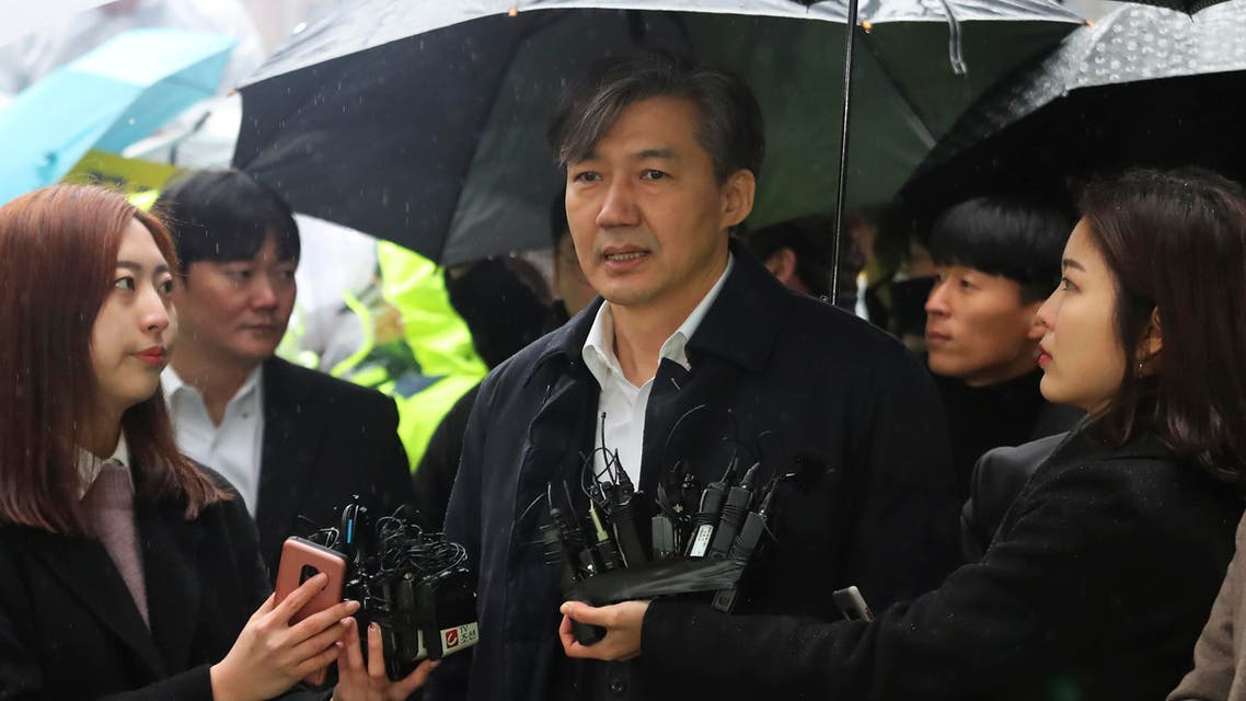 Former Justice Minister Cho Kuk, center, speaks upon his arrival at the Seoul Eastern District Court in Seoul, South Korea, Thursday, Dec. 26, 2019 (AP)