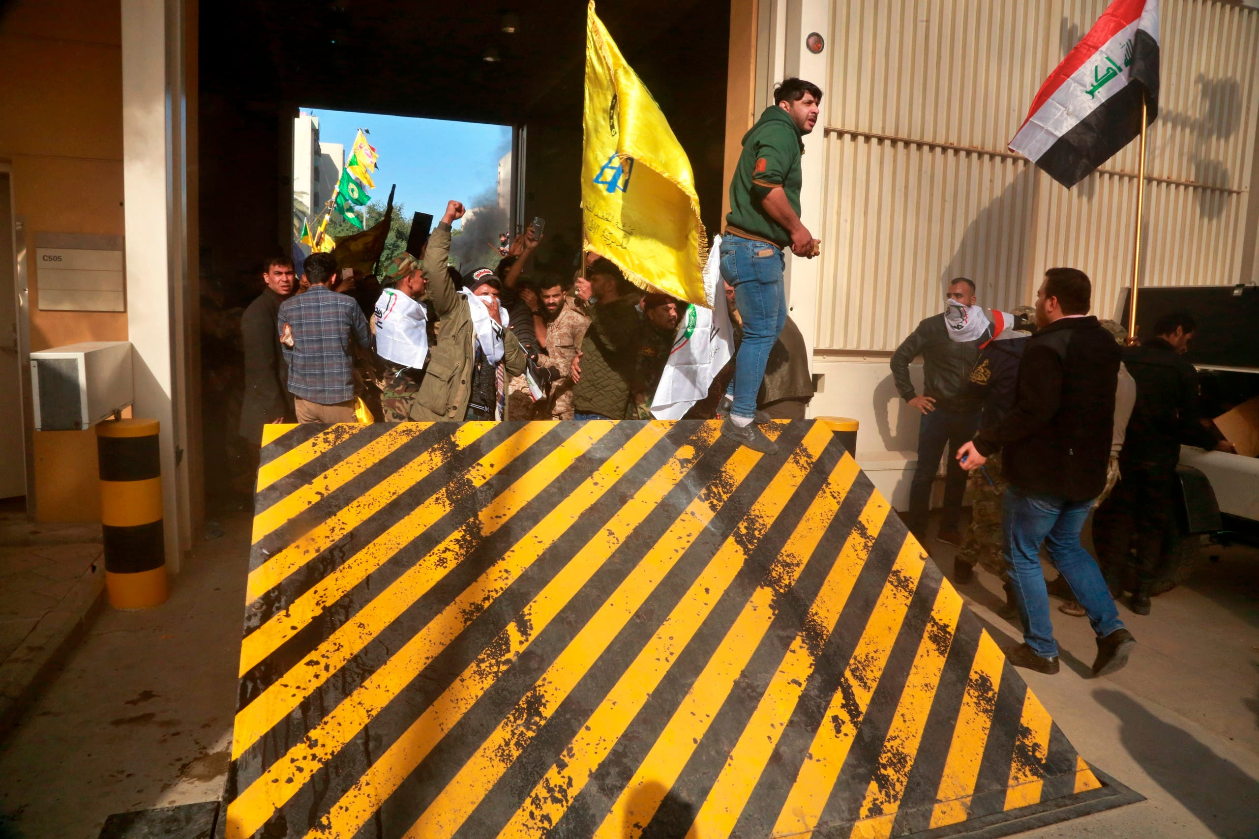 Shiite militia supporters break into the U.S. embassy compound, in Baghdad, Iraq, Tuesday, Dec. 31, 2019. (AP)
