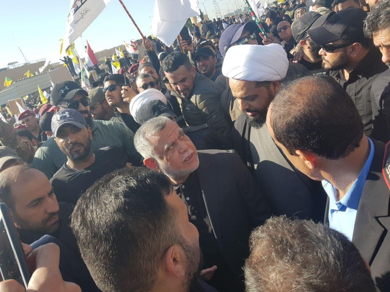 قيس الخزعلي و هادي العامري زعيما ميليشيا العصائب وبدر يقودان اقتحام السفارة الأميركية