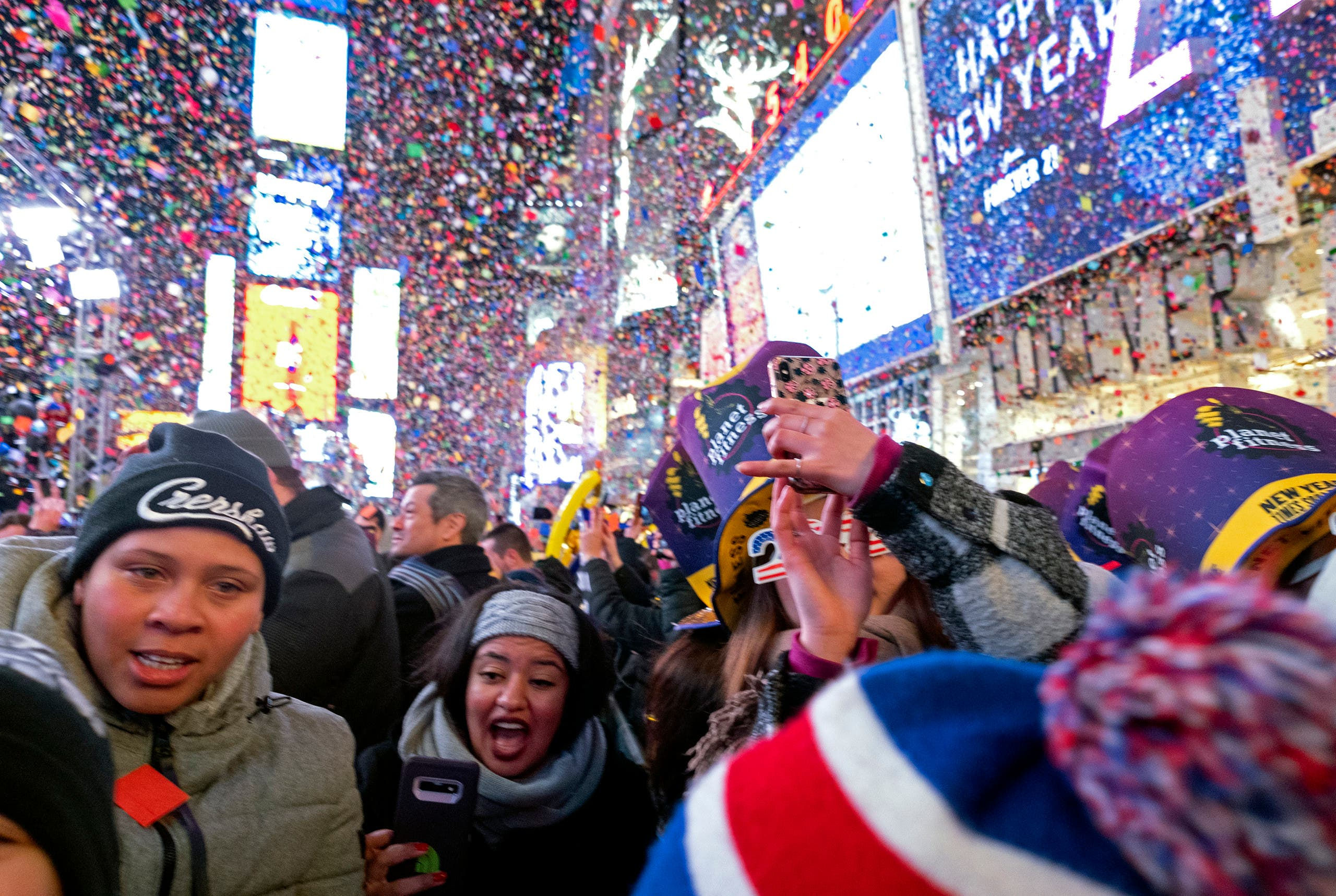 Confetti falls during a New Year's celebration in New York's Times Square, Wednesday, Jan. 1, 2020. (AP Photo/Adam Hunger)