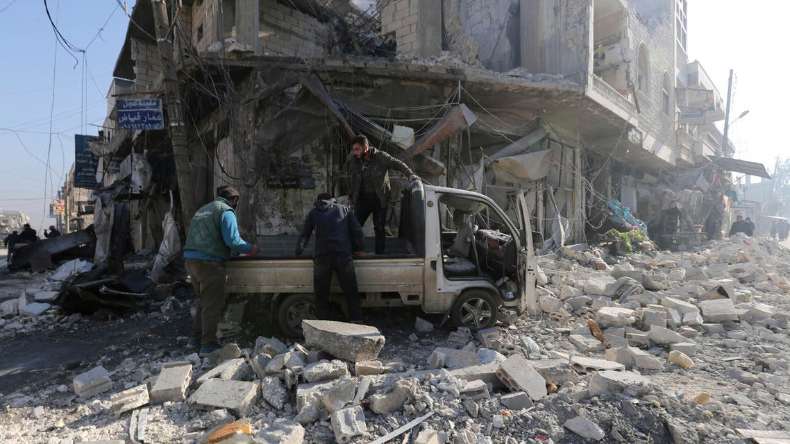 People gather in the the market in the city of Saraqeb in the Idlib countryside after an air strike by Syrian aircraft on Saturday, Dec. 21, 2019. (AP)