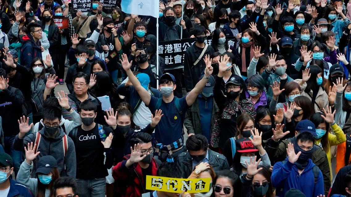 Hong Kong people participate in their annual pro-democracy march on New Year's Day to insist their five demands be matched by the government in Hong Kong on Jan. 1, 2020. (Photo: AP)