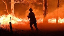 Some flee, others restock before Australia's wildfires grow