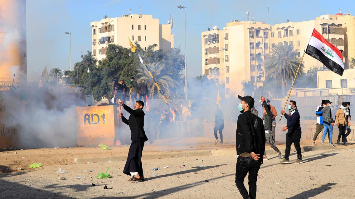 Protesters and militia fighters during a protest outside the US Embassy in Baghdad on January 1, 2020. (Photo: Reuters)