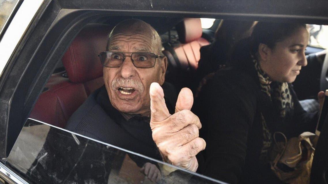 Algerian war veteran Lakhdar Bouregaa gestures in a car upon his release in Algiers on January 2, 2020. (AFP)