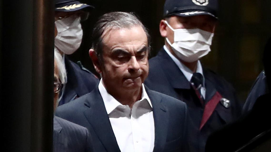 In this file photo taken on April 25, 2019 former Nissan chairman Carlos Ghosn (C) is escorted as he walks out of the Tokyo Detention House following his release on bail in Tokyo. (File photo: AFP)
