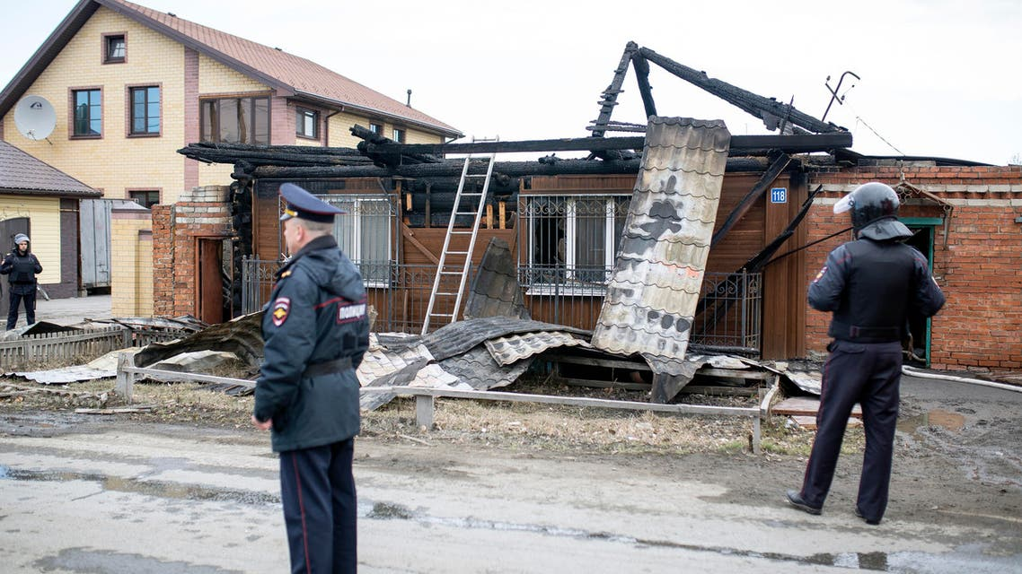 Police officers guard the scene at a private residence where two supporters of the Islamic State group were killed in a shootout with security forces in Tyumen, about 1700 kilometers (1100 miles) east of Moscow, Russia, Saturday, April 13, 2019. (AP)