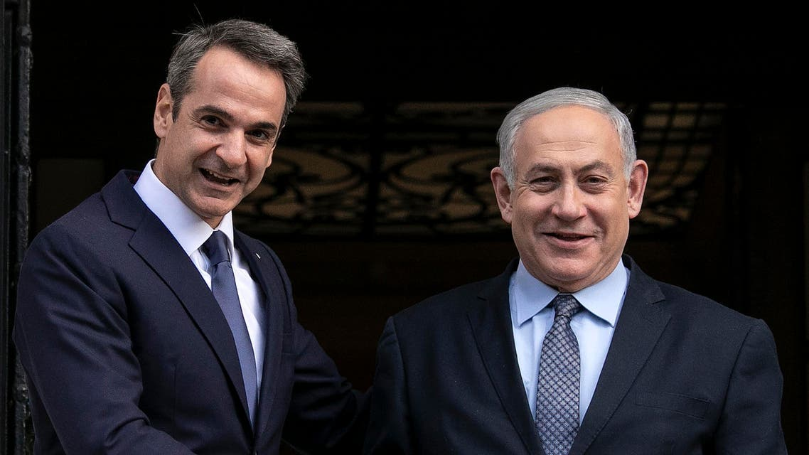 Greece's Prime Minister Kyriakos Mitsotakis, left, welcomes his Israeli counterpart Benjamin Netanyahu in Athens, Thursday, Jan. 2, 2020. (AP)
