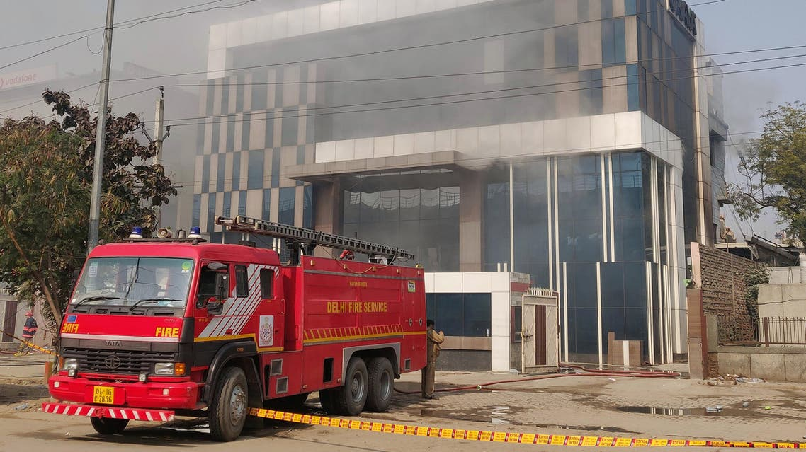 A Delhi Fire Service truck is parked next to the site of a fire and building collapse at a factory for Okaya batteries in New Delhi on January 2, 2020. (AFP)
