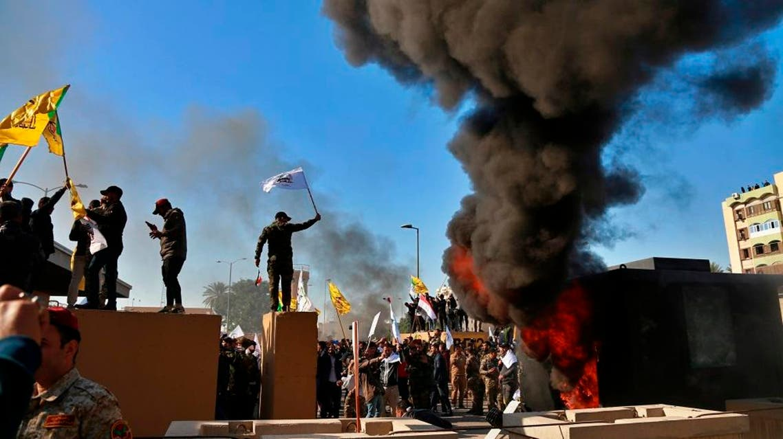 Protesters burn property in front of the US embassy compound, in Baghdad, Iraq, Tuesday, December 31, 2019. (AP)