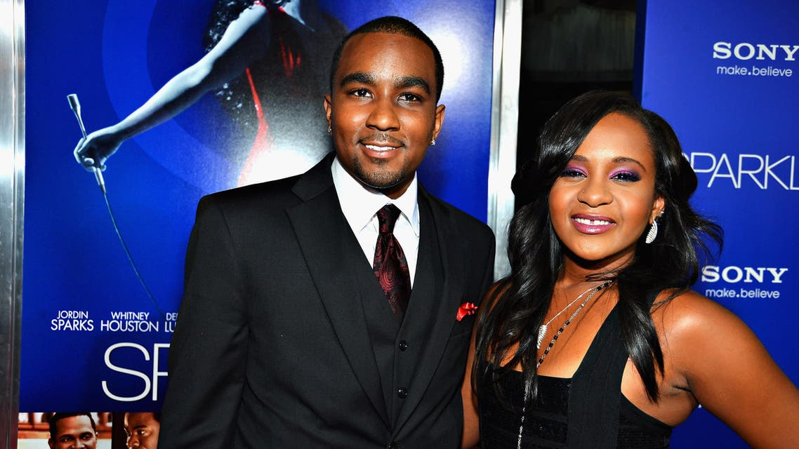 """Whitney Houston's daughter Bobbi Kristina Brown and her boyfriend Nick Gordon arrive for the premiere of """"Sparkle"""" at Grauman's Chinese Theater in Hollywood, California on August 16, 2012. (File photo: AFP)"""