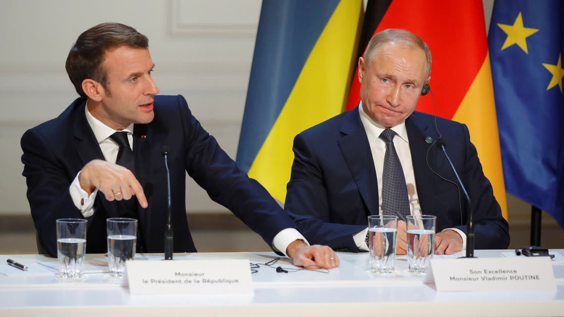 French President Emmanuel Macron and Russia's President Vladimir Putin attend a joint news conference after a Normandy-format summit in Paris, France December 9, 2019. REUTERS/Charles Platiau/Pool
