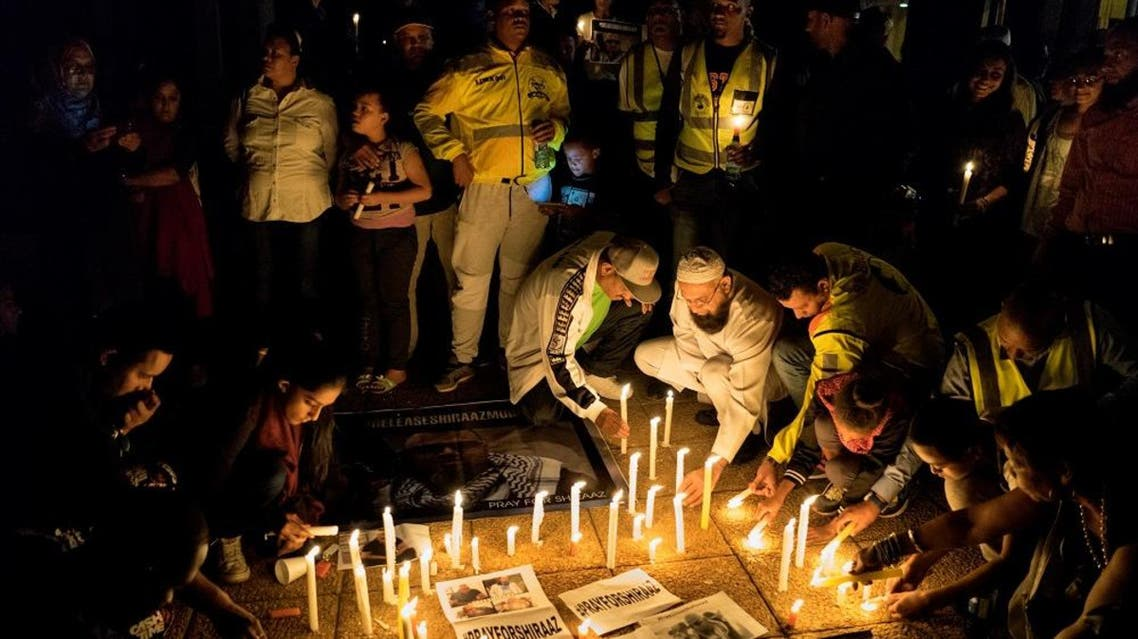 Journalists and community members take part in a vigil in Johannesburg on January 18, 2017 to demand the release of the South African photojournalist Shiraaz Mohamed, who was kidnapped at gunpoint in northwestern Syria, near the Turkish border last week. MARCO LONGARI / AFP
