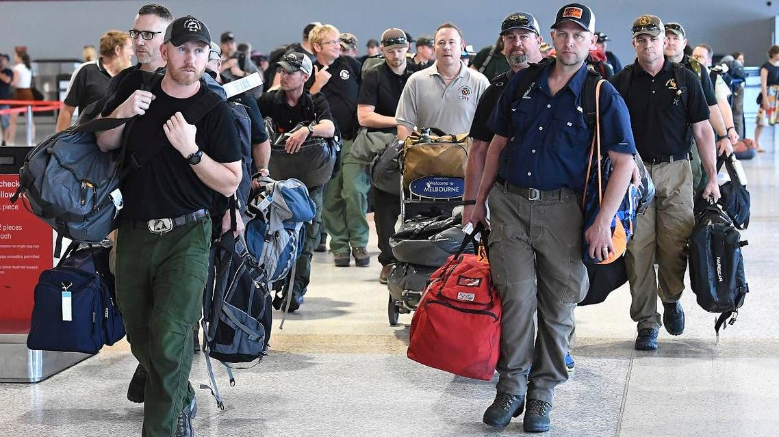 A contingent of 39 firefighters from the United states and Canada arrive at Melbourne Airport in Melbourne, Thursday, January 2, 2020. The firefighters will assist local crews with ongoing fires burning across Victoria. (AP)