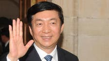 China replaces its top official in protest-riven Hong Kong