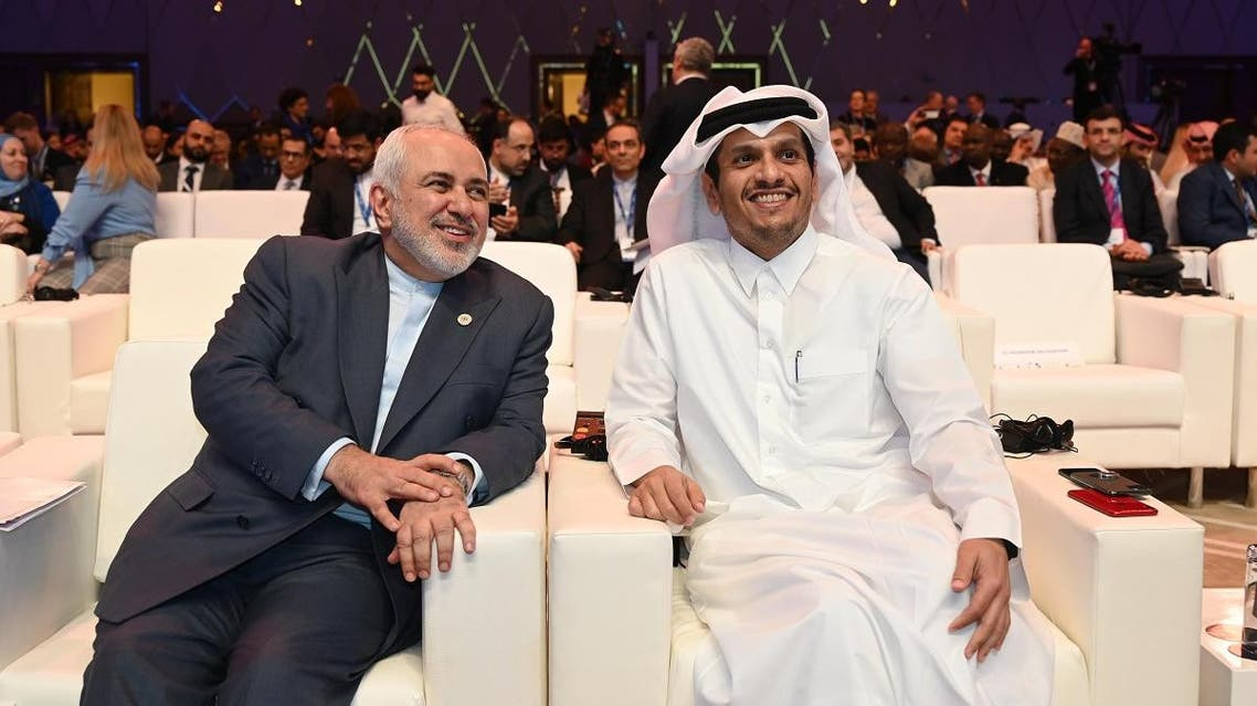 Javad Zarif, Iran Foreign Affairs Minister (L) and Sheikh Mohammed bin Abdulrahman bin Jassim Al Thani, Foreign Affairs Minister of Qatar (R) attend the Doha Forum 2019 in Doha, Qatar, December 15th of 2019. (File photo: AFP)