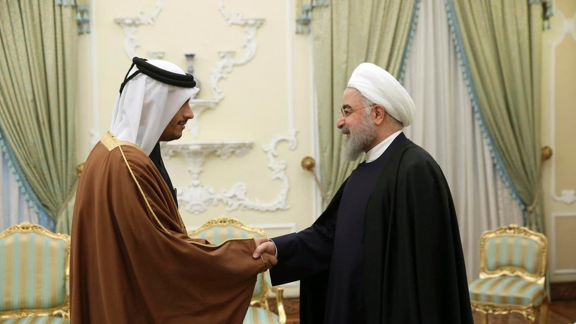 In this photo released by the official website of the office of the Iranian Presidency, President Hassan Rouhani, right, welcomes Qatari Foreign Minister Sheikh Mohammed bin Abdulrahman Al Thani for their meeting in Tehran, Iran, Saturday, Jan. 4, 2020. (AP)