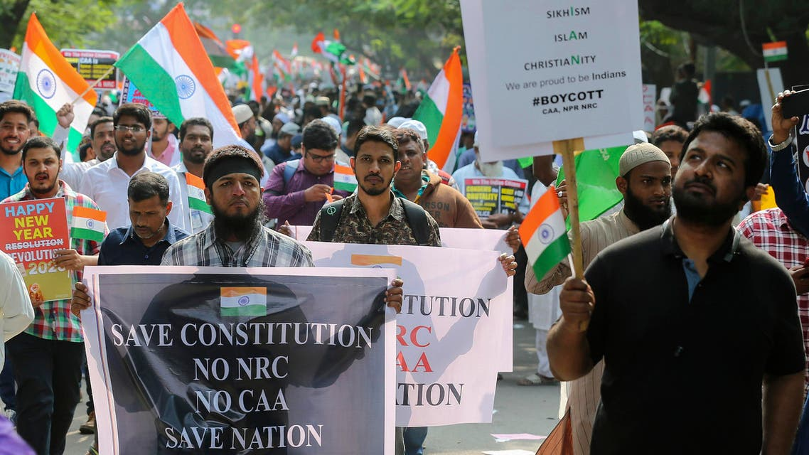 Indians hold placards as they march during a protest against a new citizenship law that opponents say threatens India's secular identity in Hyderabad, India. (AP)