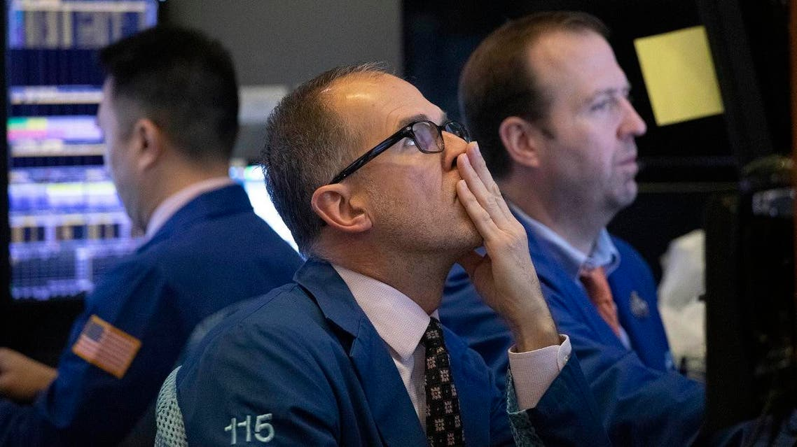 Traders monitor stock prices at the New York Stock Exchange. (AP)