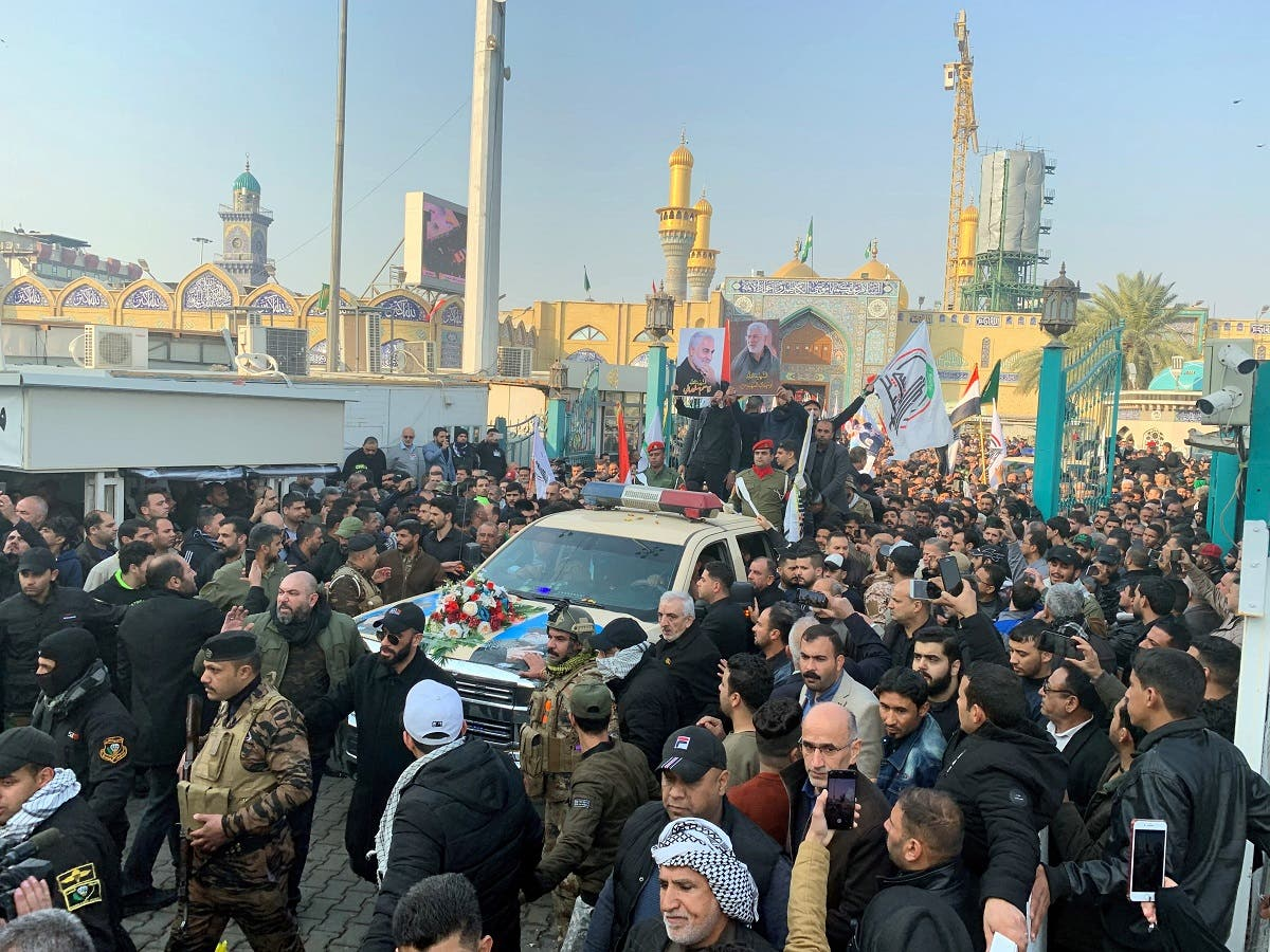 Mourners surround a car carrying the coffin of slain Iranian IRGC Commander Qassem Soleimani during a funeral procession in Kadhimiya, Baghdad, on January 4, 2020. (Photo: AFP)