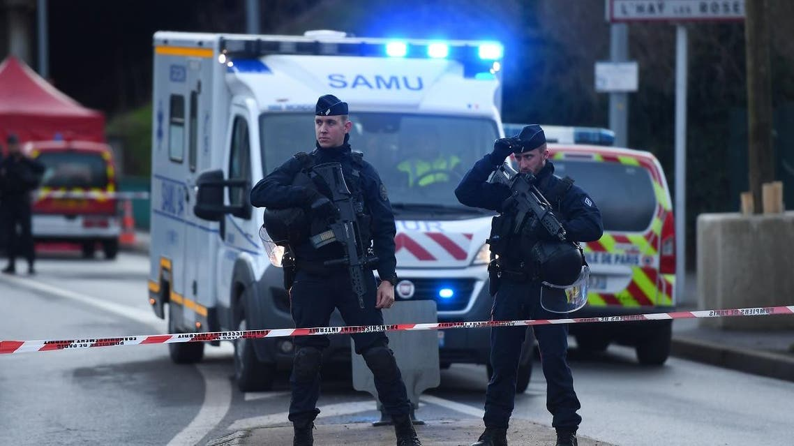 Police officers stand guard on January 3, 2020 in L'Hay-les-Roses on the site where police shot dead a knife-wielding man who killed one person and injured at least two others. (AFP)