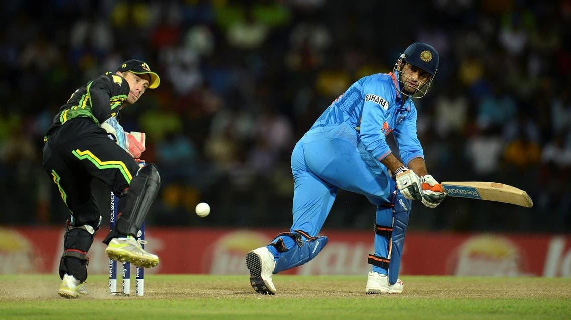 India's Pathan gets the ball past Australia's Wade during the ICC World Twenty20 Super 8 cricket match at the R Premadasa Stadium in Colombo. (File photo: Reuters)