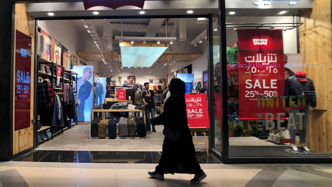 Dhahran, Saudi Arabia A Saudi woman walks in front of the famous American jeans brand outlet Levi's in the Mall of Dhahran, Saudi Arabia, December 17, 2018. Picture taken December 17, 2018. REUTERS/Hamad I Mohammed