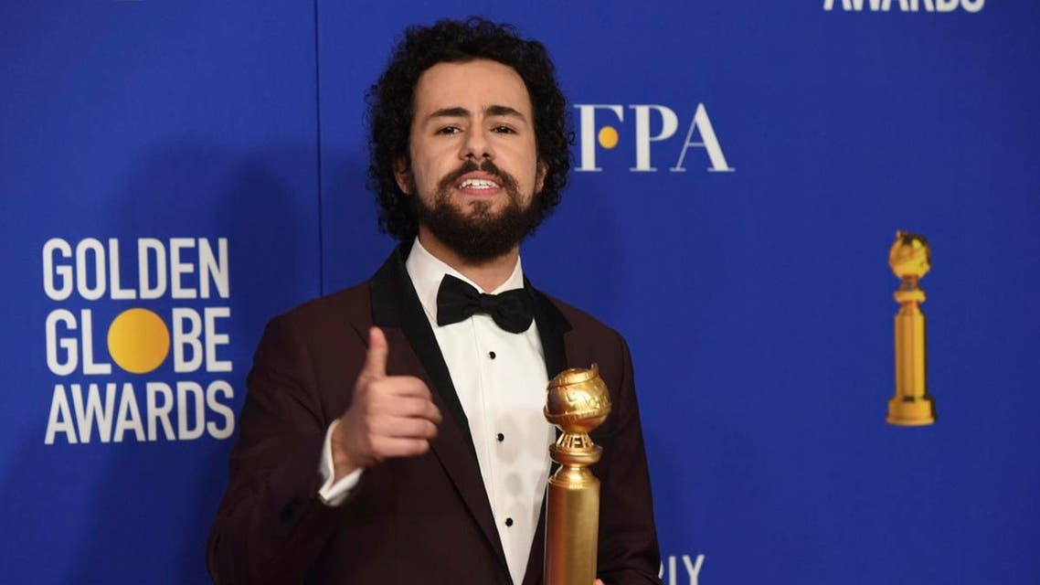 Ramy Youssef poses in the press room with the award for best performance by an actor in a television series, musical or comedy. (AP)