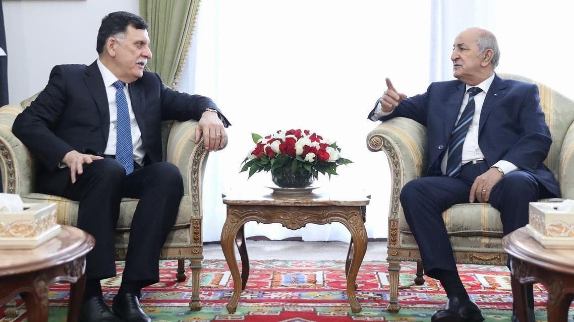 Algeria's President Abdelaziz Tebboune (R) meets with Libya's UN-recognised Prime Minister Fayez al-Sarraj upon his arrival in Algiers on January 6, 2020 for talks on the Libyan crisis. (AFP)