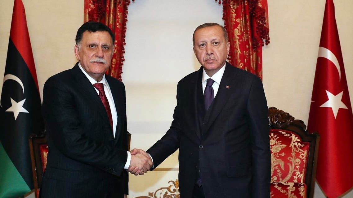 Turkey's President Recep Tayyip Erdogan, right, shakes hands with Fayez al Sarraj, the head of Libya's internationally recognised government, prior to their talks in Istanbul, Sunday, Dec. 15, 2019. (AP)