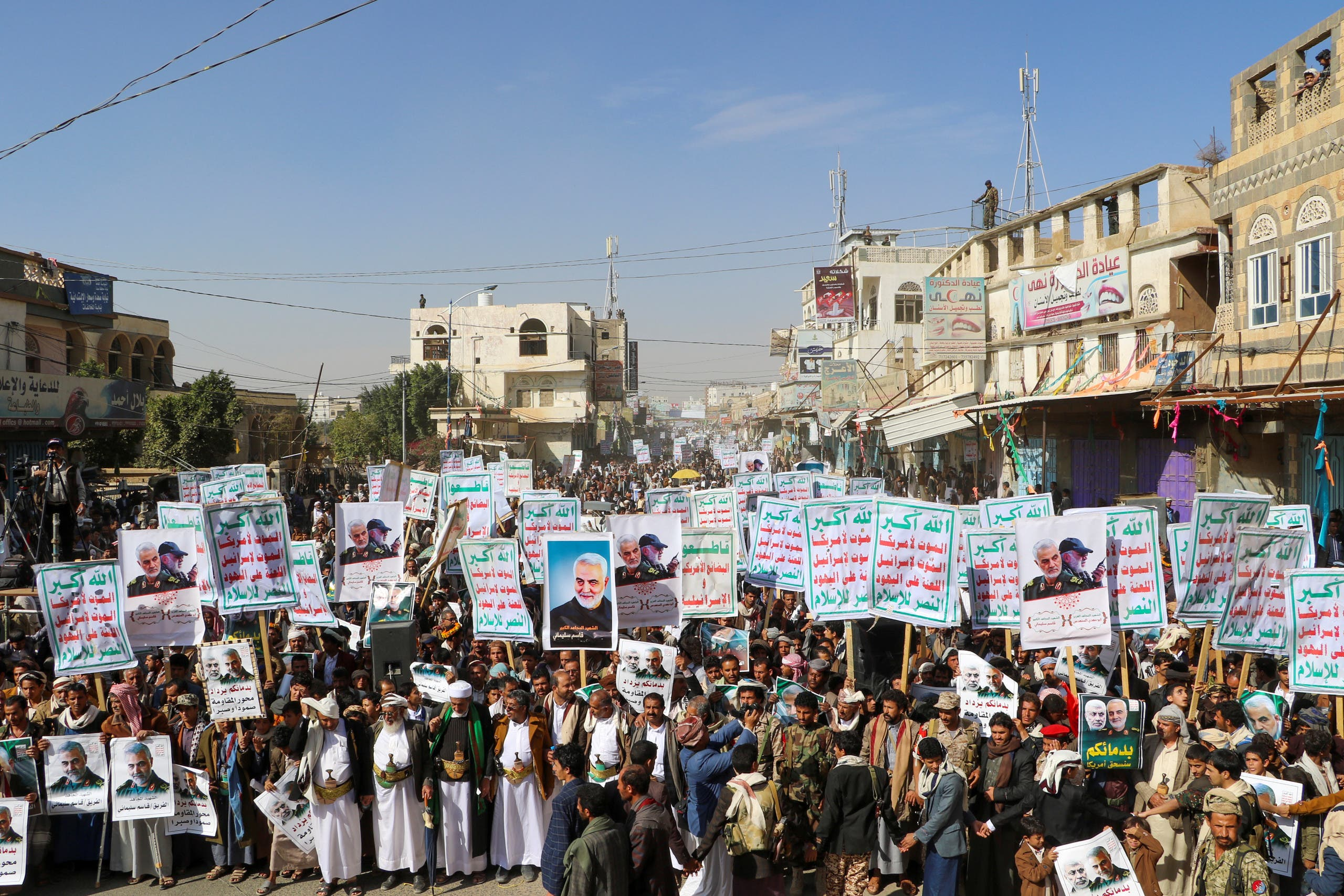 "Supporters of the Houthis hold placards that read: ""God is the Greatest, Death to America, Death to Israel, Curse on the Jews, Victory to Islam"" in Saada, Yemen January 6, 2020. (Reuters)"