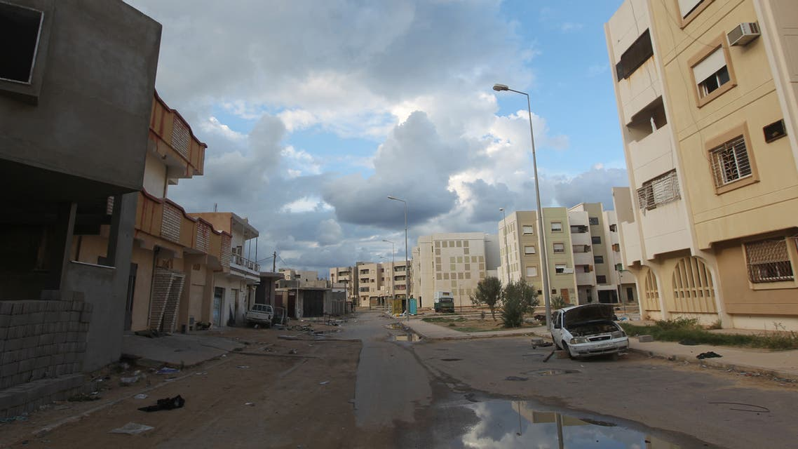 The main road in central Sirte is deserted after civilians fled the area amid fierce battles between fighters of Libya's new rulers and loyalist troops on October 13, 2011. AFP PHOTO / AHMAD AL-RUBAYE