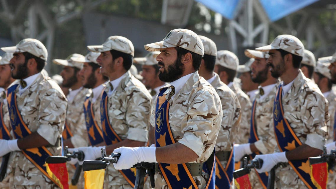 In this Sept. 22, 2011 photo, members of Iran's Revolutionary Guard march in front of the mausoleum of the late Iranian revolutionary founder Ayatollah Khomeini, just outside Tehran, Iran, during armed an forces parade marking the 31st anniversary of the start of the Iraq-Iran war. (AP)