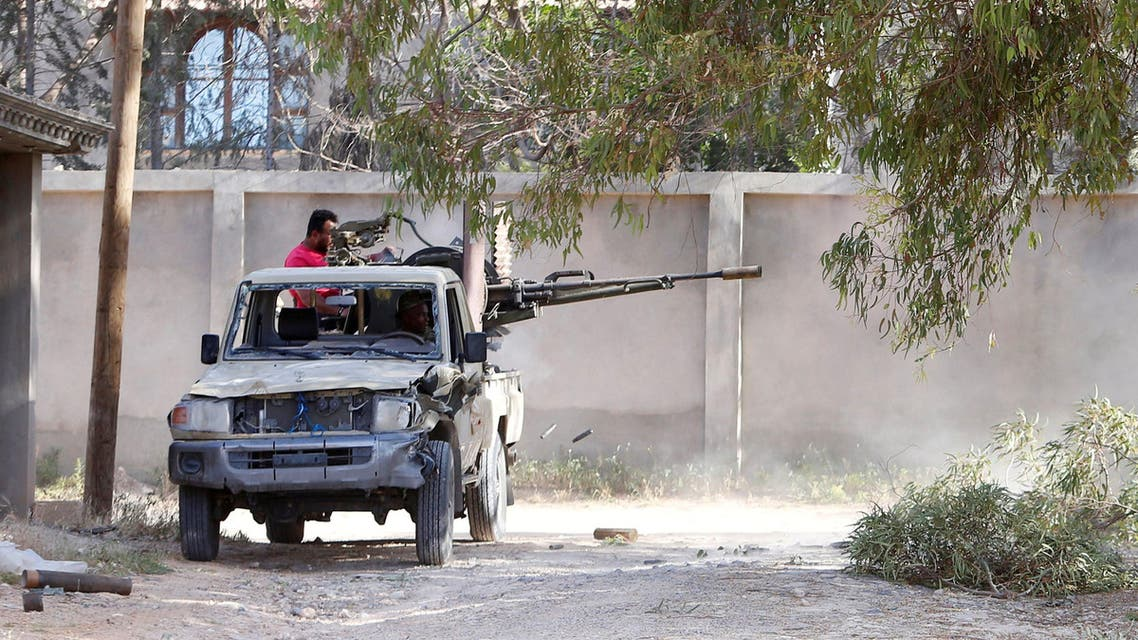 Members of the Libyan internationally recognised government forces fire during a fight with Eastern forces in Ain Zara, Tripoli