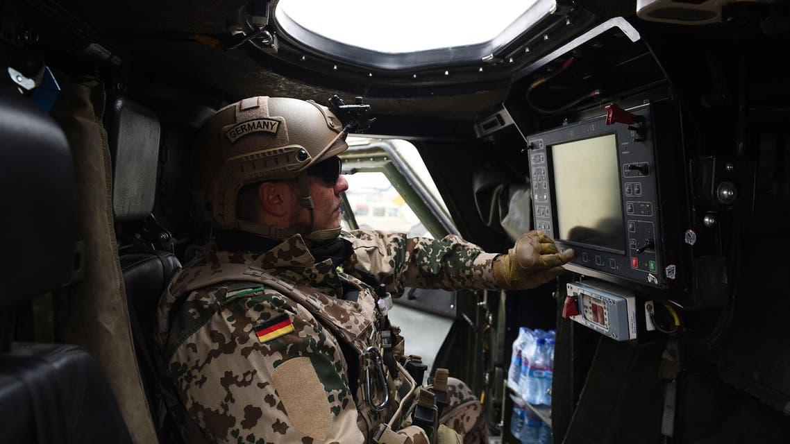 A German soldier controls a machine gun as he displays a paroling military vehicle. (File photo: AFP)
