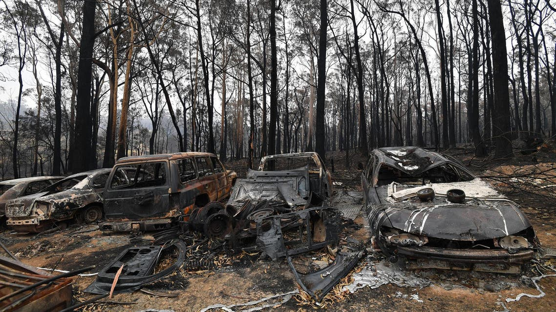 This picture taken on January 6, 2020 shows charred vehicles gutted by bushfires in Australia's New South Wales state. (AFP)