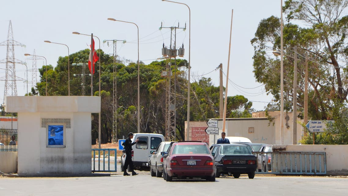 Vehicles cross the Tunisian-Libyan border of Ras Jedir on May 14, 2016. Tunisian and Libyan authorities have reached a deal to lift a trade blockade at their main border crossing, officials said after angry street protests. The breakthrough came after an agreement was reached late Friday related to customs duties for goods passing through Ras Jedir, local governor Tahar Matmati said.