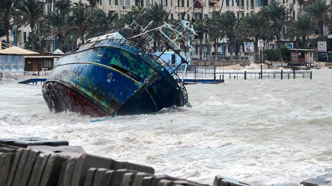 A picture taken on January 19, 2018 shows waves breaking against the hull of a ship on the shore of the Egyptian port city of Alexandria during the annual winter storm. (File photo: AFP)
