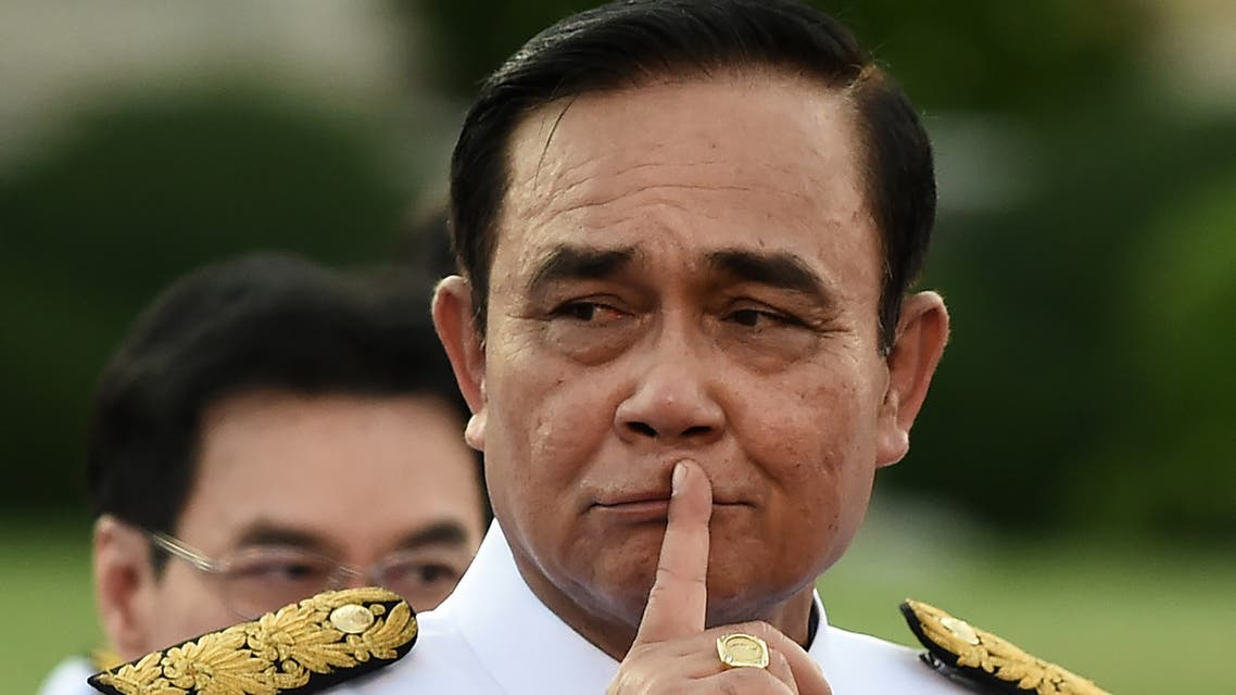 Thailand's Prime Minister Prayut Chan-O-Cha gestures as he arrives for a photo opportunity with members of the new Thai cabinet at Government House in Bangkok on July 16, 2019.