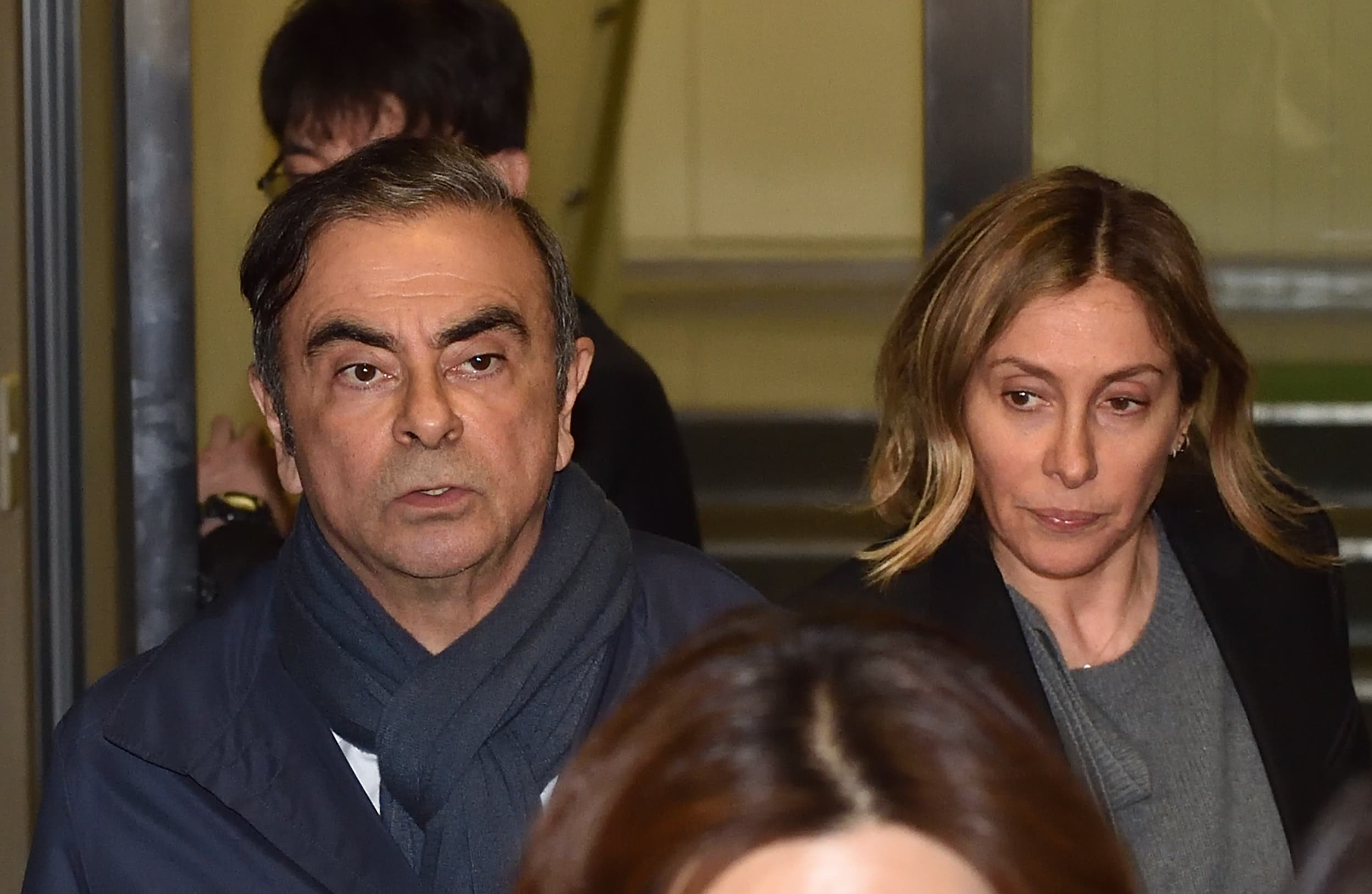 Former Nissan Chairman Carlos Ghosn (L) and his wife Carole (R) leave the office of his lawyer in Tokyo. (AFP)