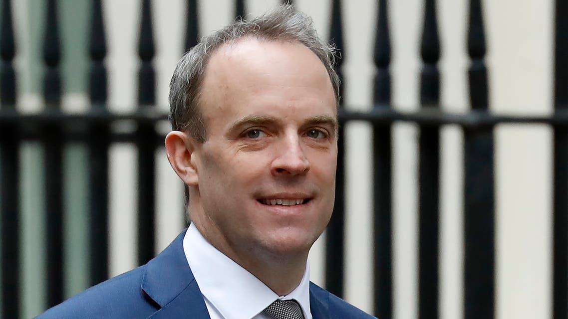 Britain's Foreign Secretary and First Secretary of State Dominic Raab carries a cup as he walks to the door of 10 Downing Street in central London on January 6, 2020.