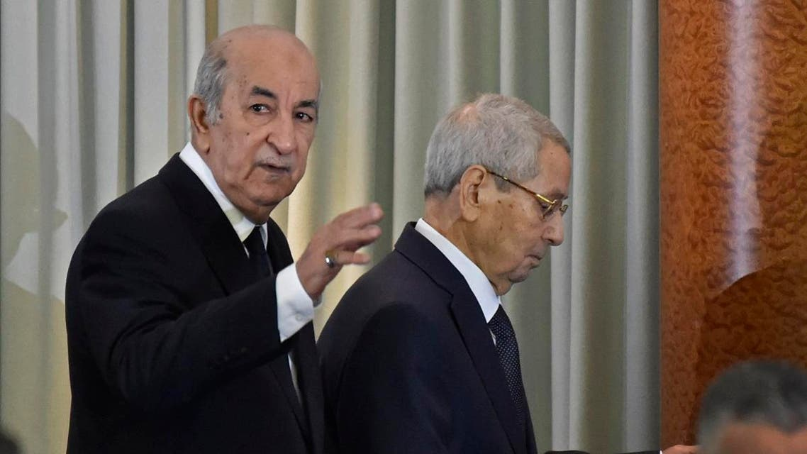Algerian President-elect Abdelmadjid Tebboune (L) arrives with interim president Abdelkader Bensalah during the formal swearing-in ceremony in the capital Algiers on December 19, 2019. (AFP)