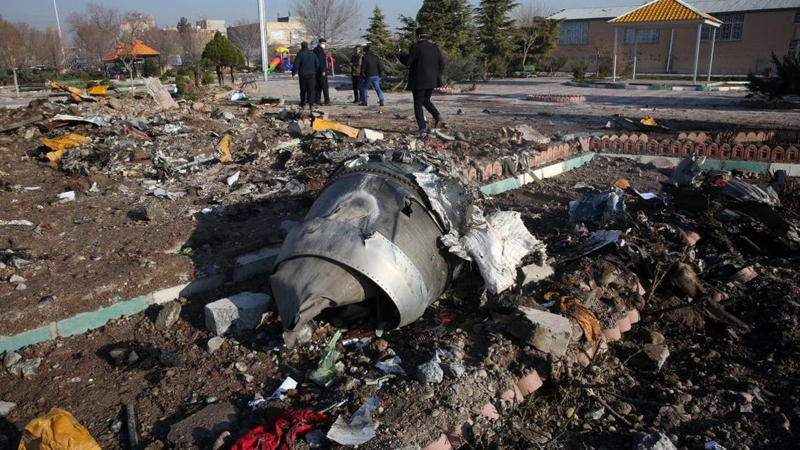 Rescue teams work amidst debris after a Ukrainian plane carrying 176 passengers crashed near Imam Khomeini airport in the Iranian capital Tehran early in the morning on January 8, 2020. (AFP)