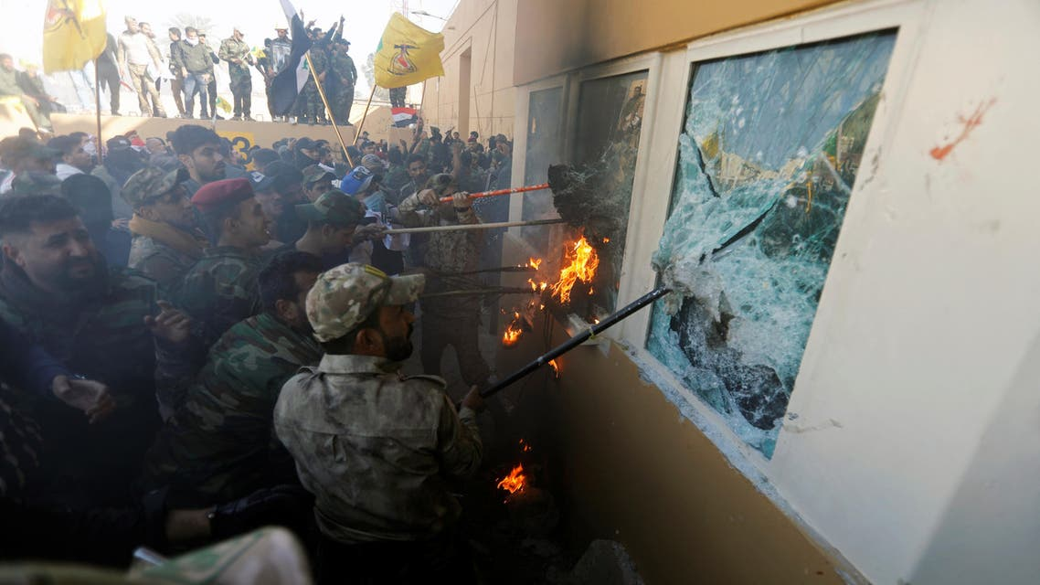 Militia fighters attack the US Embassy in Baghdad on December 31, 2019. (Photo: Reuters)